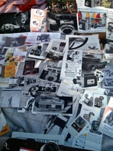 My bed covered with vintage camera images